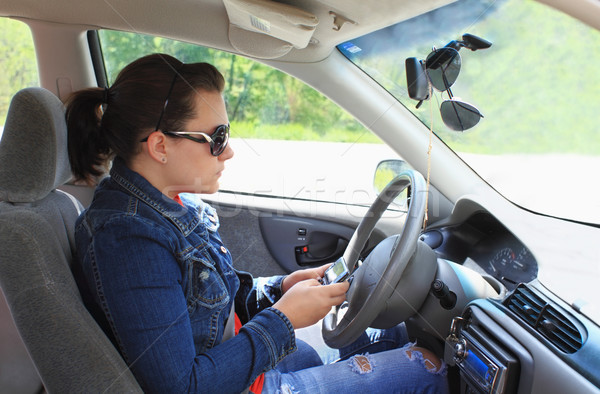 Teen Texting While Driving Stock photo © StephanieFrey