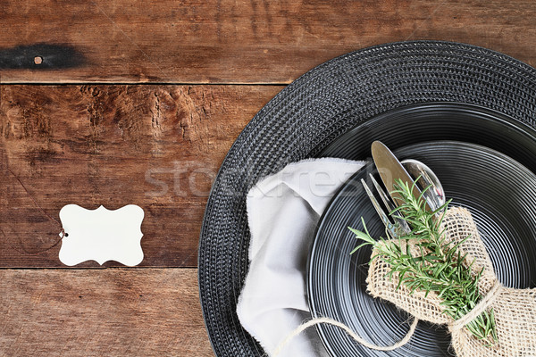 Card and Place Setting of Black Dinnerware over Wooden Backgroun Stock photo © StephanieFrey