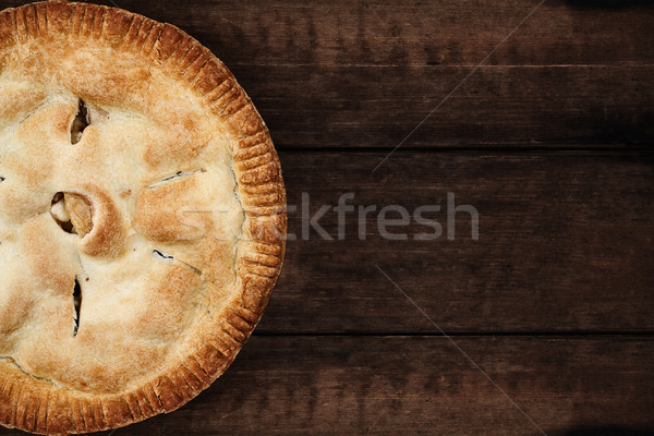 Stock photo: Apple Pie Over a Dark Wooden Table Top