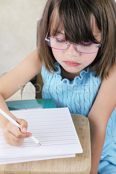 Child Sitting at School Desk With Glasses Stock photo © StephanieFrey