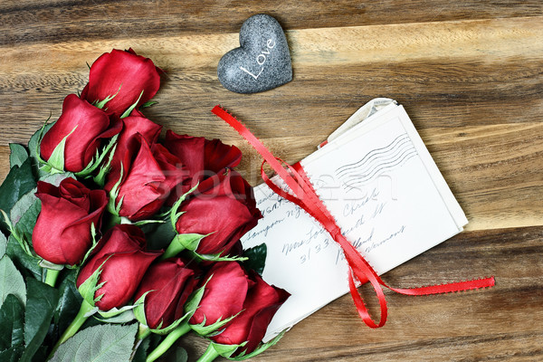 Dozen Roses with Old Letters Stock photo © StephanieFrey