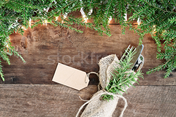 Pine Needles and Lights with Silverware and Card over Wooden Bac Stock photo © StephanieFrey