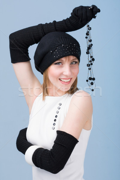 knitwear. woman wearing a winter cap and gloves Stock photo © stepstock
