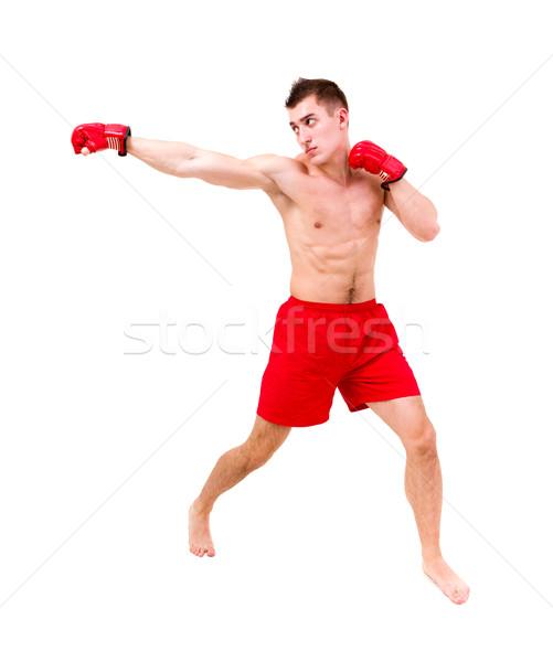 Boxer man doing exercise Stock photo © stepstock