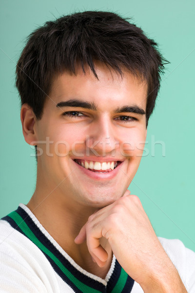 Closeup portrait of a happy young man smiling Stock photo © stepstock