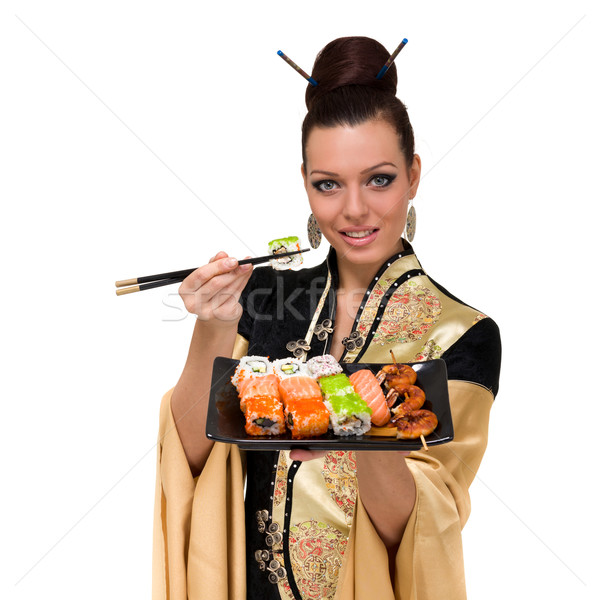 Vrouw traditioneel jurk eten sushi Stockfoto © stepstock