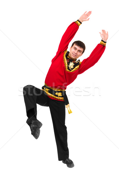 young man wearing a folk russian costume dancing Stock photo © stepstock