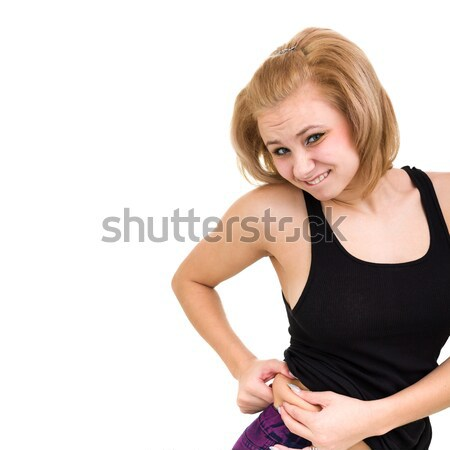Upset girl shows her fat Stock photo © stepstock