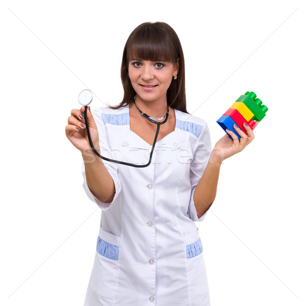 Young medic pediatrician with toys Stock photo © stepstock