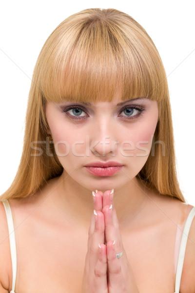 Mulher jovem oração isolado branco mãos cara Foto stock © stepstock