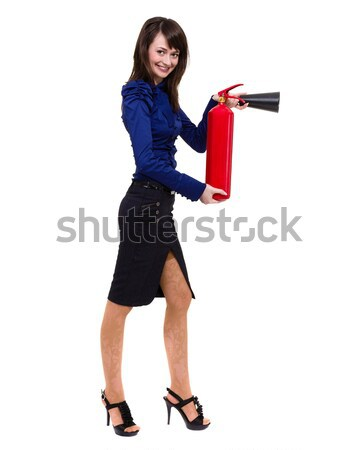 young businesswoman using a fire extinguisher Stock photo © stepstock
