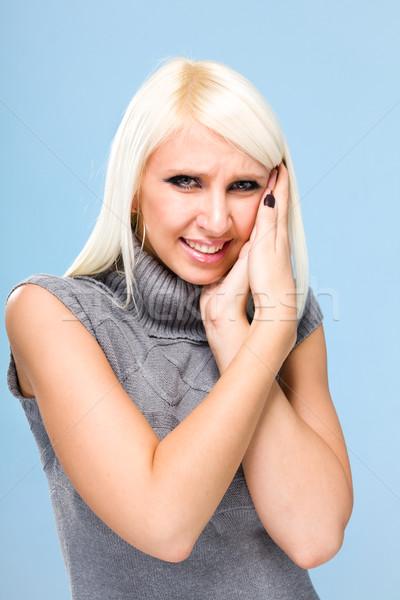 woman with a headache holding head Stock photo © stepstock