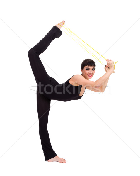 Young smiling acrobat posing Stock photo © stepstock
