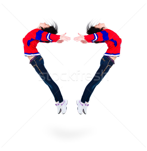 Jumping young woman forming a heart shape Stock photo © stepstock
