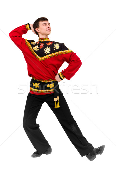 Stock photo: young dancer wearing a folk russian costume dancing
