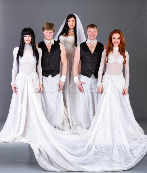 Esküvői ruha pózol szürke teljes alakos lány mosoly Stock fotó © stepstock