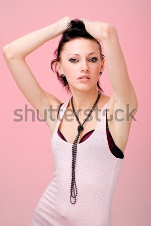 portrait of beautiful young woman on white Stock photo © stepstock