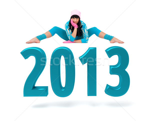 Young woman and 2013 New Year sign Stock photo © stepstock