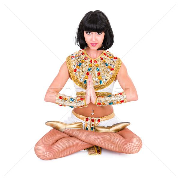 Yoga woman wearing a egyptian costume. Stock photo © stepstock