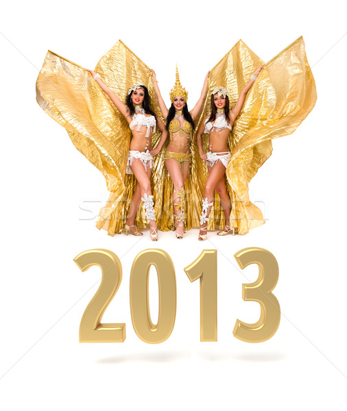 Three belly dancers with 2013 New Year gold sign Stock photo © stepstock