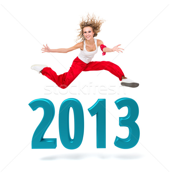 woman jumping over a 2013 New Year sign Stock photo © stepstock