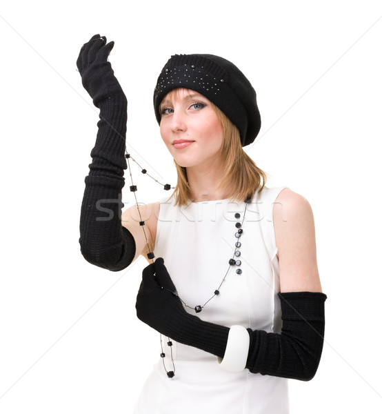 knitwear. woman wearing a winter cap and gloves with black necklace Stock photo © stepstock
