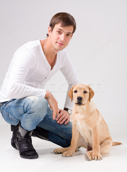 Stock photo: handsome man with dog over gray