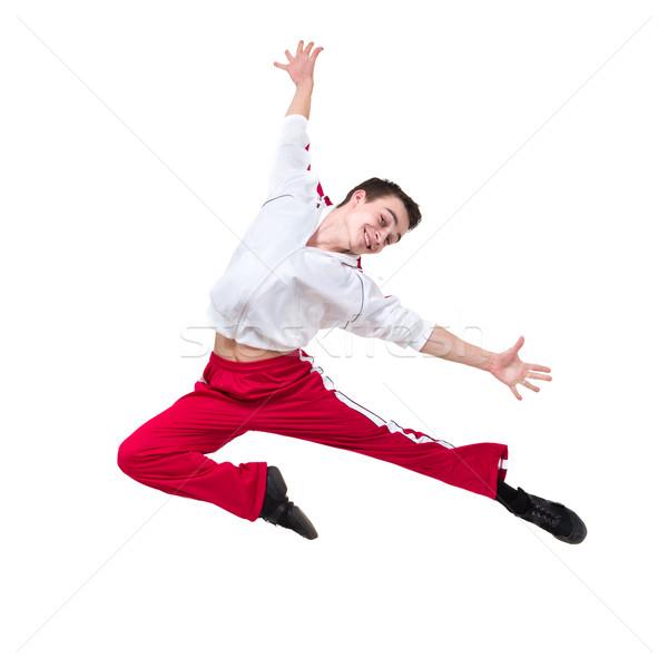 Jovem dançarina saltando isolado branco sorrir Foto stock © stepstock