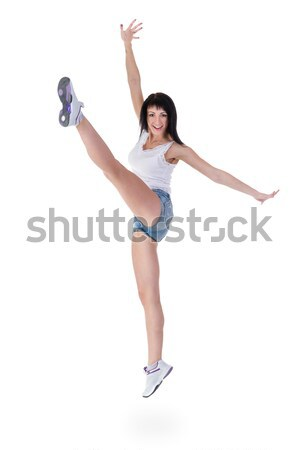 Young smiling fitness woman with holding gesture Stock photo © stepstock
