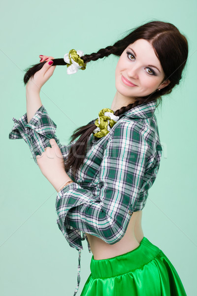 funny cute smiling woman with pigtails  on green Stock photo © stepstock