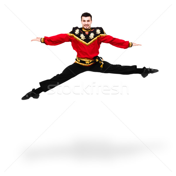 young dancer man wearing a folk russian costume jumping Stock photo © stepstock