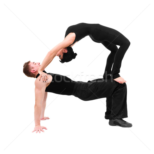 two young modern acrobats posing on white Stock photo © stepstock
