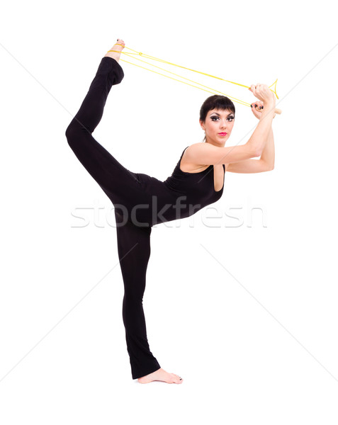 athlete woman doing stretching with skipping rope Stock photo © stepstock