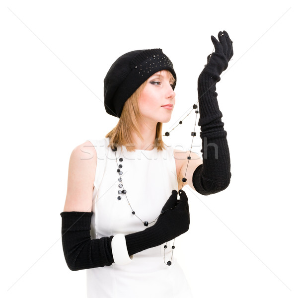 woman in knit wool hat with black necklace Stock photo © stepstock