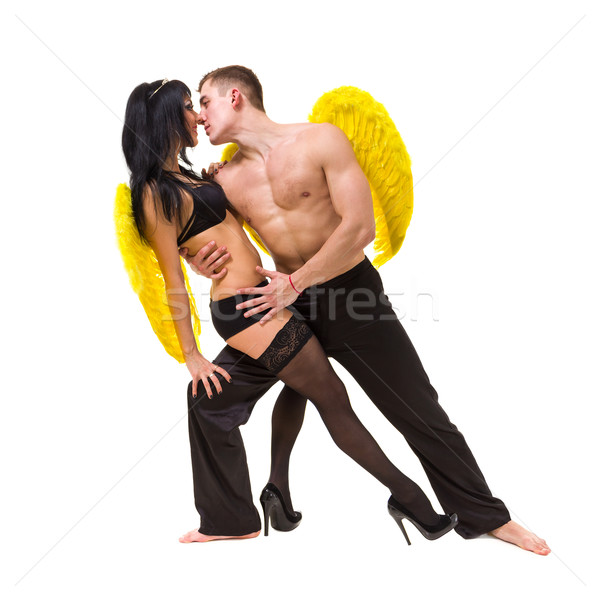 Young sexy couple with yellow wings Stock photo © stepstock