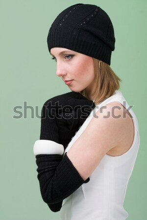 knitwear. young woman wearing a winter cap Stock photo © stepstock