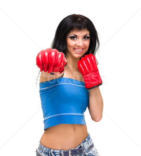 Young woman with boxing gloves at workout Stock photo © stepstock