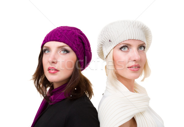 two sisters in knit wool hat and mittens Stock photo © stepstock