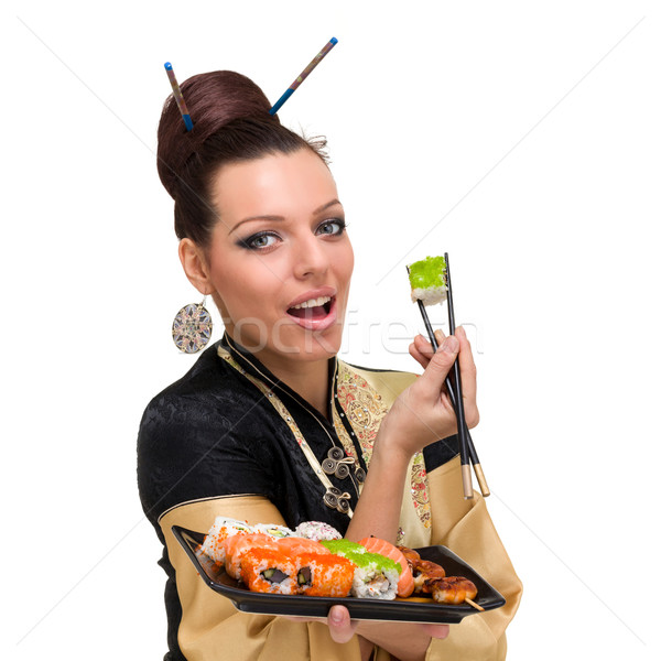 Close up portrait of young woman with sushi Stock photo © stepstock
