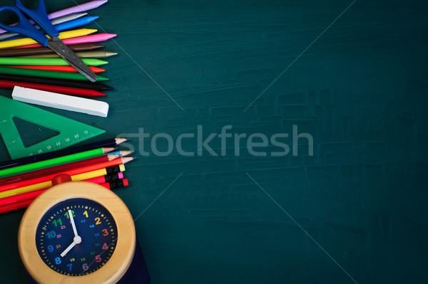 Back to School Background with School Supplies and Alarm Clock Stock photo © stickasa