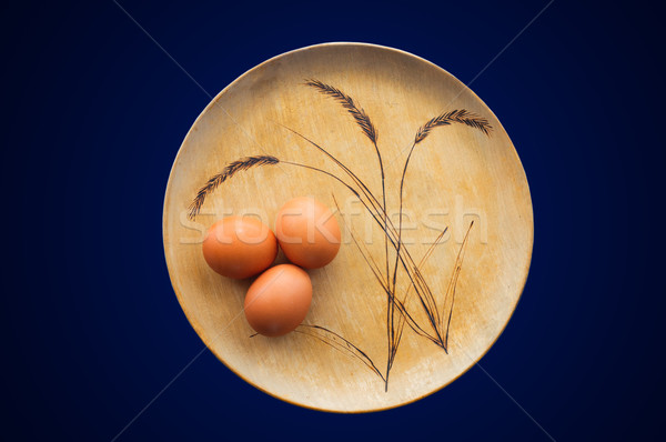 Brown Eggs on Wooden Plate Stock Photo  Stock photo © stickasa