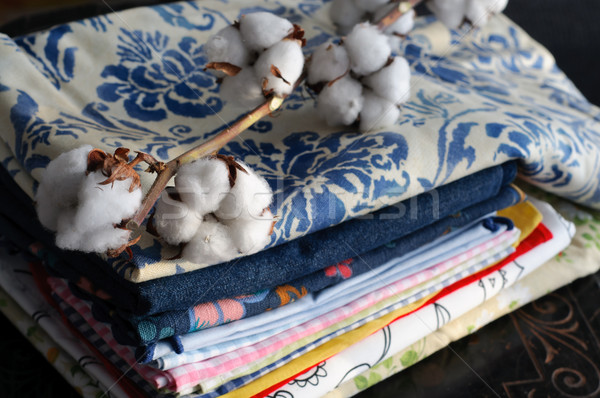 Pile of Fabric and Cotton Plant Stock Photo Stock photo © stickasa