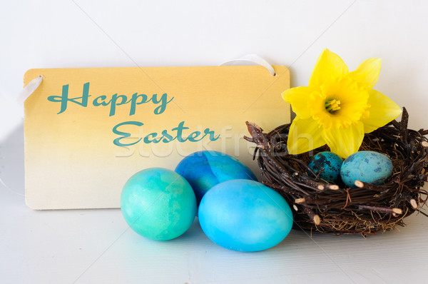 Happy Easter Decoration with Blue Eggs and Yellow Flower Stock photo © stickasa
