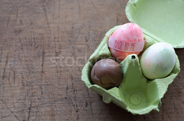 Chocolate Egg and Hand Mage Egg in Egg Package Stock photo © stickasa