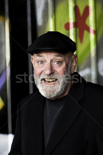 Mutlu yaşlı adam bakmak siyah ekmek ağız Stok fotoğraf © stockfrank