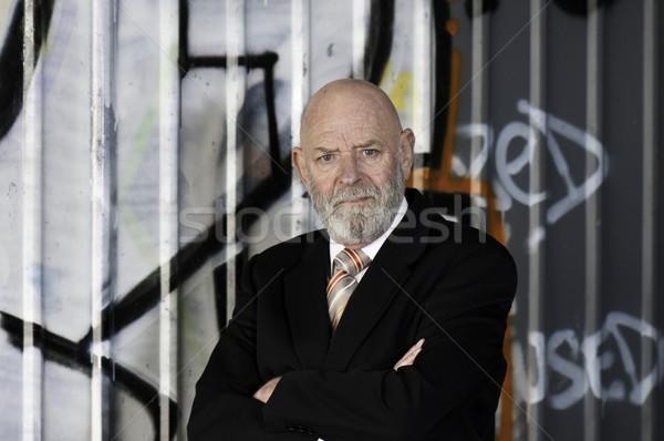 деловой человек человека костюм граффити хлеб Сток-фото © stockfrank