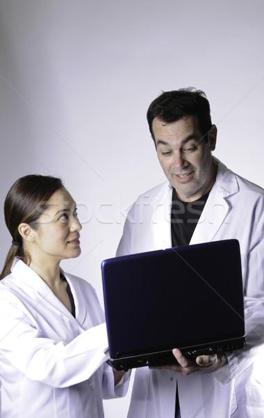 глядя компьютер женщины мужчины медицинской Сток-фото © stockfrank