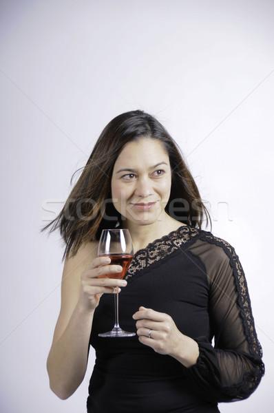 Сток-фото: женщину · глядя · сторона · стекла · вино · улыбка