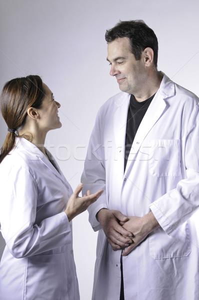 два человека говорить молодые Lady человека Сток-фото © stockfrank