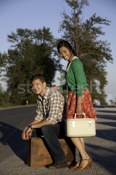 Boy and girl at roadside with suitcase Stock photo © stockfrank
